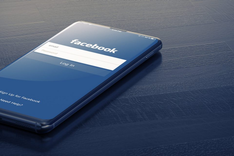 KYIV, UKRAINE-JANUARY, 2020: Facebook on Smart Phone Screen. Social Media are Most Popular Tool for Communication Sharing Information and Content Between People in Internet. 3D Render.