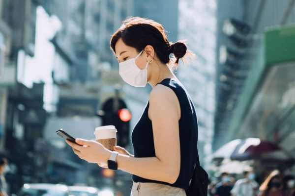 young-asian-woman-with-protective-face-mask-holding-royalty-free-image-1620802456